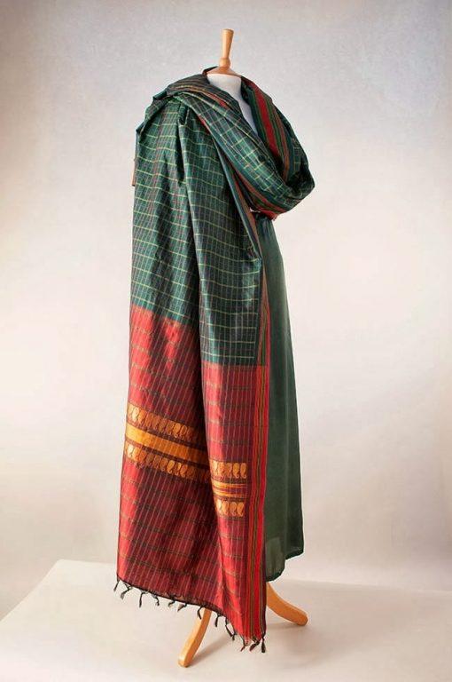 Silk sari in rich dark green with dark red pallu